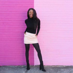 tanaye white in front of pink wall